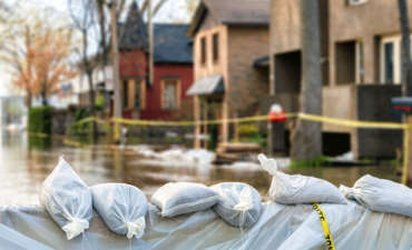 sandbags in front of flooded streets