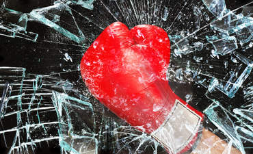 Boxing glove breaking glass