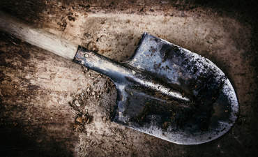 A shovel on soil