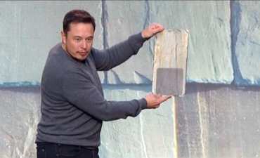 Tesla debuts sleek glass solar rooftop tiles featured image