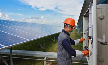 Engineer checking solar panels