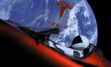 Starman in the Tesla car with the Earth in the background