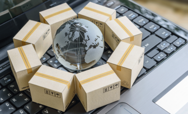 Globe with shipping boxes on computer