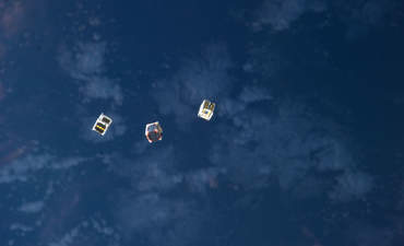 Tiny satellites released outside the International Space Station.