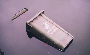 recycling can floating in flood
