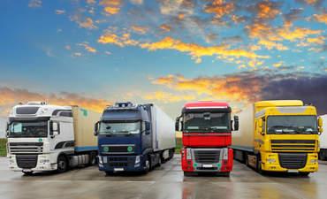 Trucks under a sunset