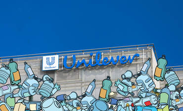 Unilever logotype on office building with illustrated plastic waste