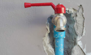 Water pipe coming out of a wall