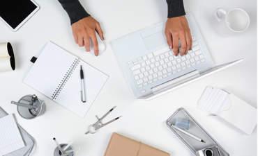 Women's hands on a desk