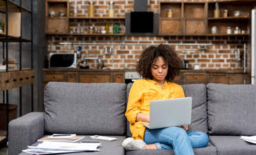 Person working working with laptop on couch