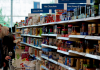 Customers shopping for food and household products in the Hove branch of Tesco, the U.K.'s biggest supermarket chain.