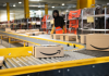 Logistics activity on the Amazon site of Vélizy-Villacoublay in France. Packages are sorted by workers on conveyors belts..