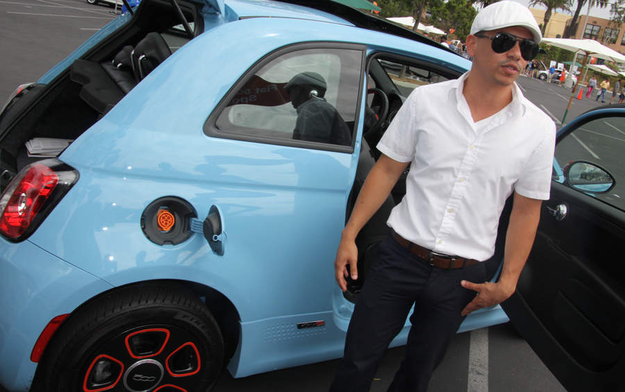 Brent Oani dresses the part as he shows off the Fiat 500e.
