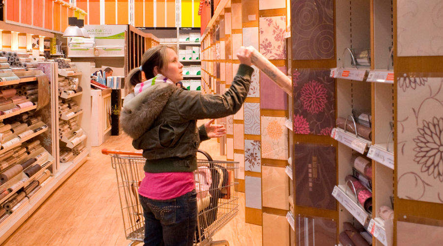A shopper examines products at B&Q UK's redesigned Farnborough store.