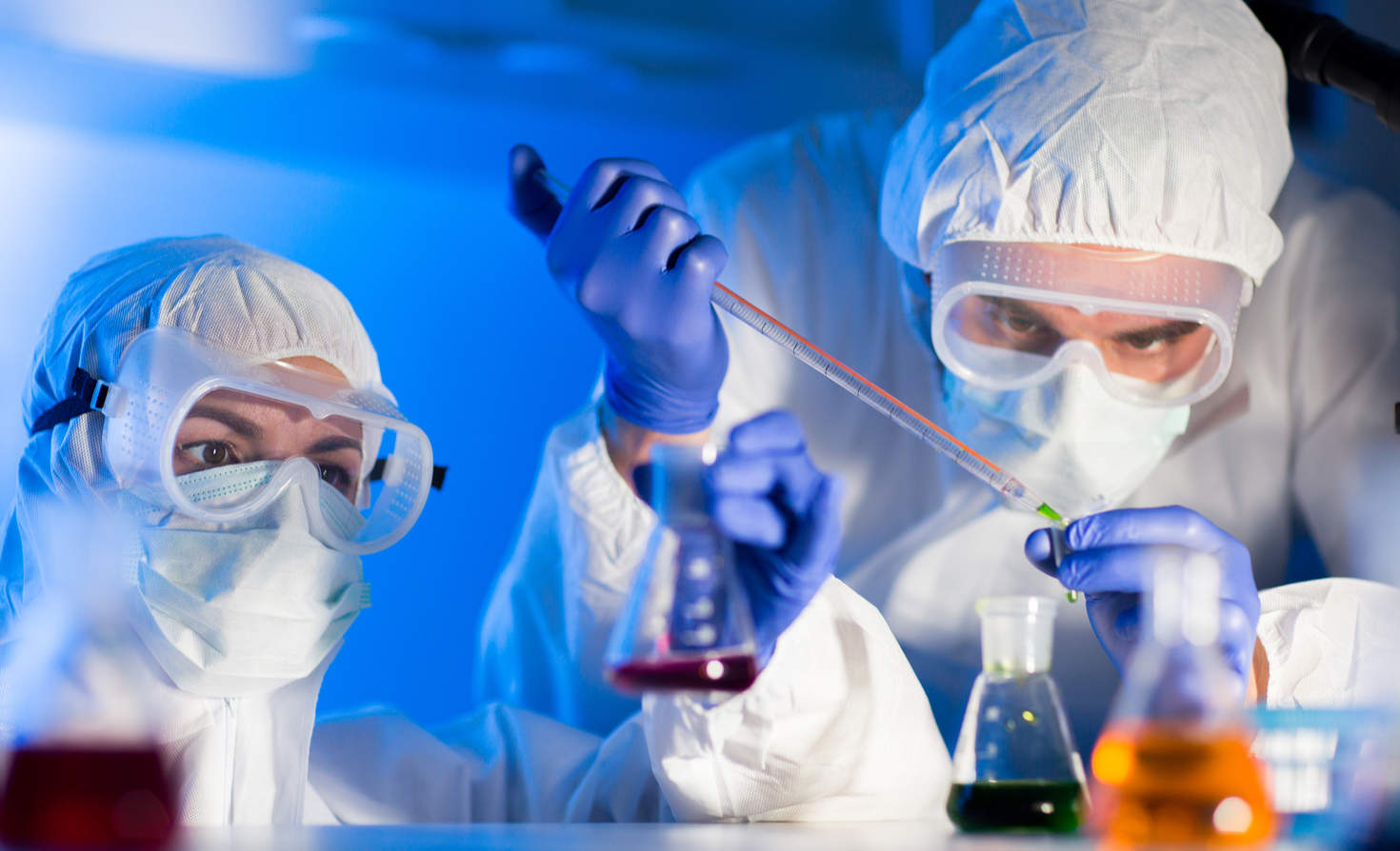 Scientists in a laboratory with chemicals