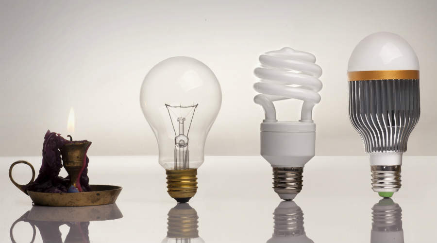 Image of candle, incandescent bulb, fluorescent bulb, and LED bulb