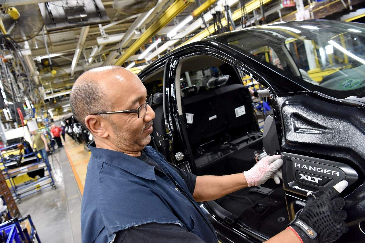 A Ford employee in Wayne, Michigan, builds a Ford Ranger truck