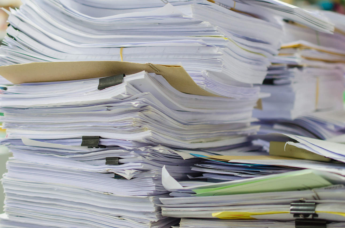 Piles of printed documents