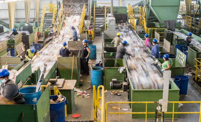 People working at the sort line in a recycling facility