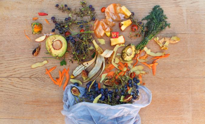 Aerial view of fruit and vegetable waste for compost in the garbage bag on the table.