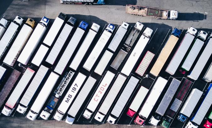 Aerial view of heavy trucks in a parking lot