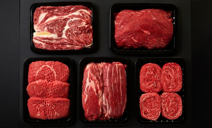 Different types of red meat in plastic boxes packaging tray
