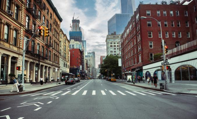 New York City street and tall buildings during summer time