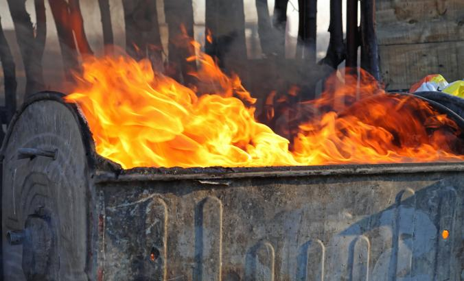 Burning trask in a dumpster