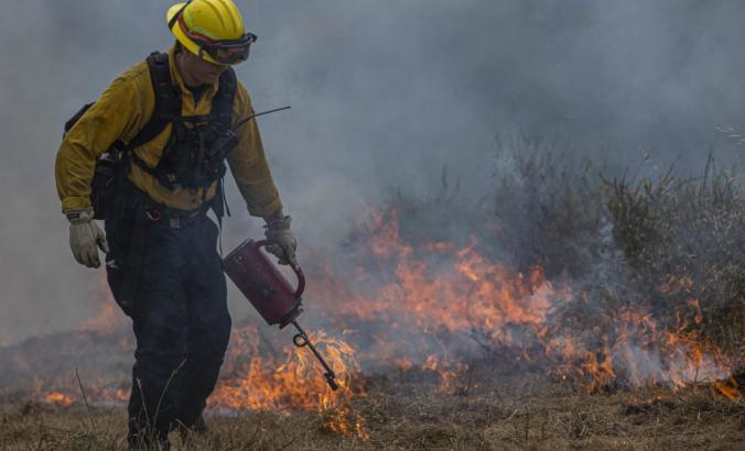 A firefighter with the Pendleton fire department in Northern California uses prescribed burns to prevent wildfires