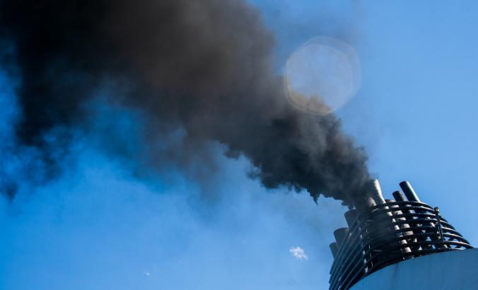 Carbon emissions coming out of a smokestack