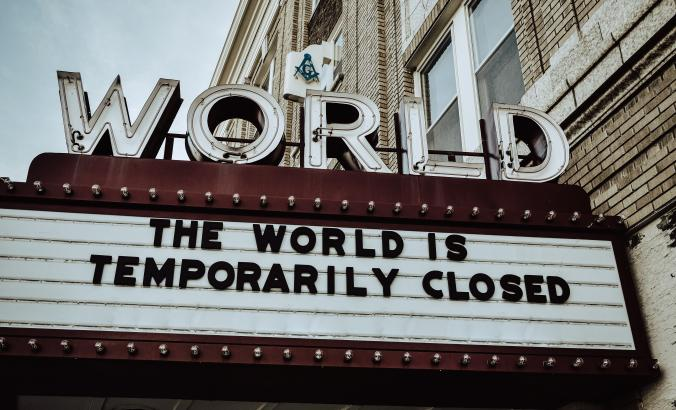sign that says the world is temporarily closed