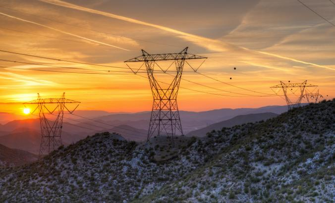 Electric power lines in a California landscape at sunset