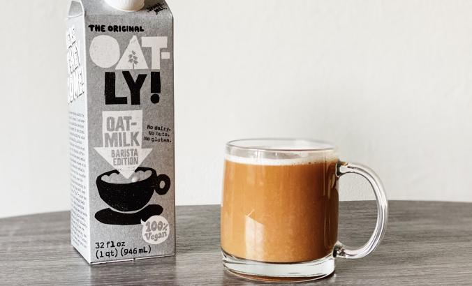Oatly milk next to coffee