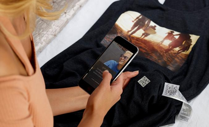 Person scans a QR code on a t-shirt with their phone