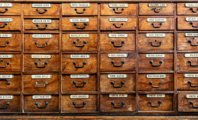 Industrial chemicals have proliferated exponentially since the time of this antique medical cabinet, and new ways of organizing them are sorely needed.