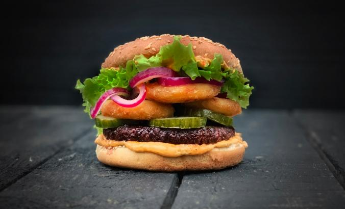 Like Burger with onion rings, lettuce and pickled onions