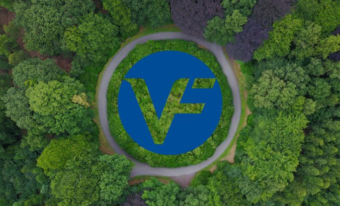 VF Corp logo embedded on image of a roundabout in the middle of a forest in Belgium.