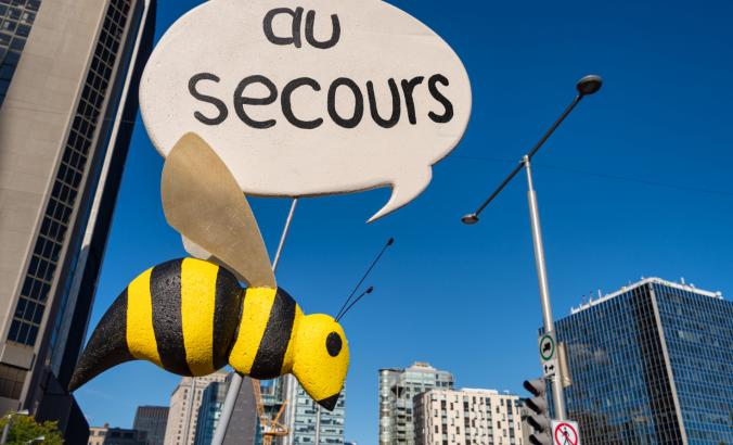 "In a Montreal protest, a plea for ""au secours,"" which means ""help"" in French."