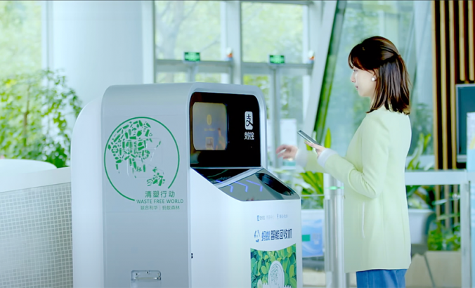 Person puts bottle into AI recycling machines
