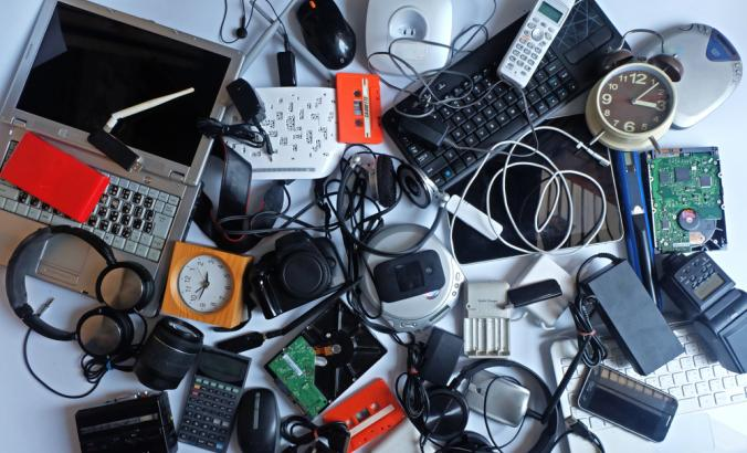 Pile of used electronic waste on white background