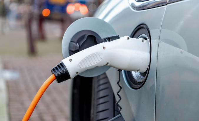 Close view of an EV being charged.