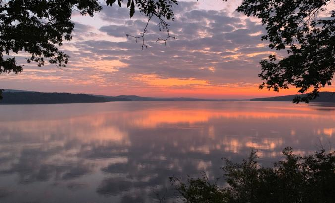Purple and orange sunrise on Lake Maumelle in Arkansas