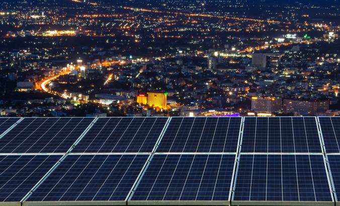 Solar panels at night in a city.