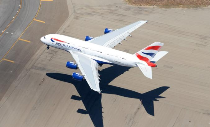 Aerial view of British Airways Airbus A380 and its shade on final approach to international airport Aerial view of A380-800 aircraft registered as G-XLEC.