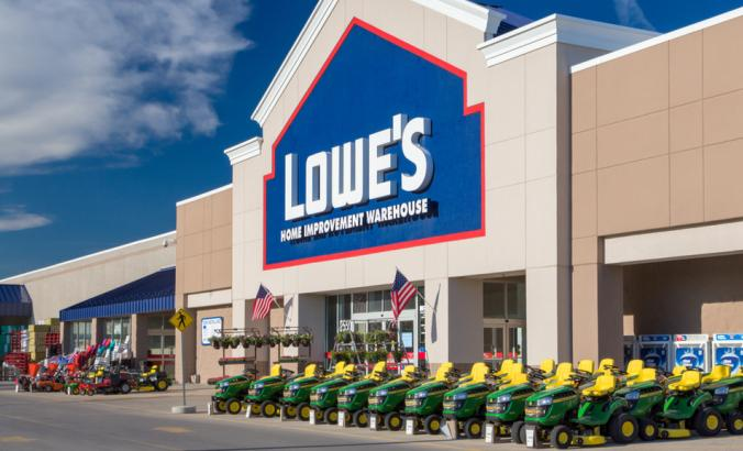 Lowe's storefront, there are gardening vehicles parked in front