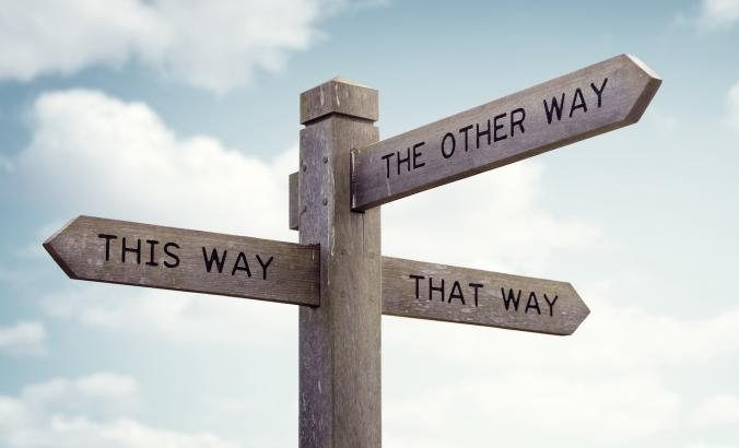 Signpost representing the directions presented by new advice
