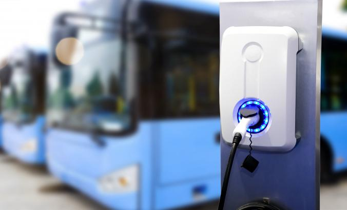 electric buses in back of a charger
